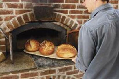 Jesse Merrill of Polestar Hearth puts bread in the oven